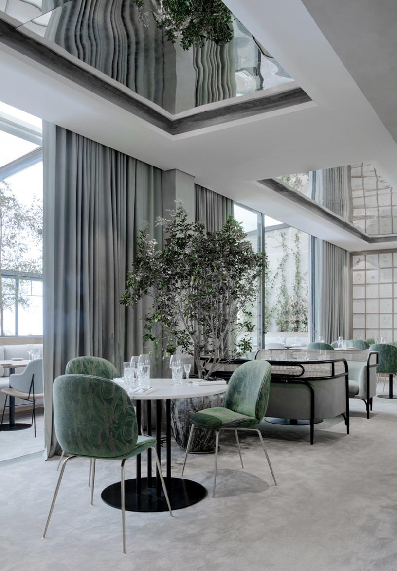 Sage-colored interior design of the Flora Danica brasserie in Paris