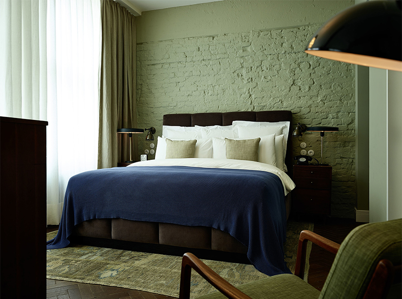 Sage-colored bedroom in the Soho House Berlin