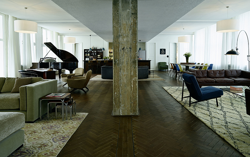 Sage-colored interior design of the lounge in the Soho House Berlin