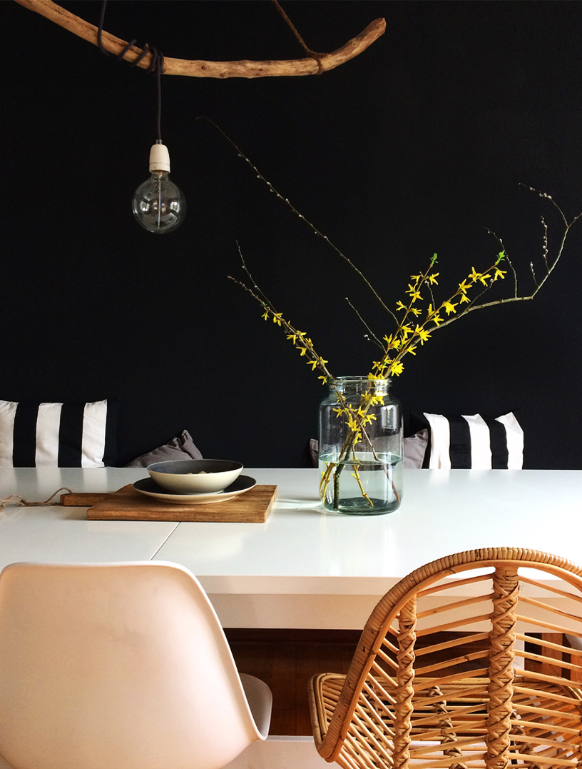 Black wall of a dining room creates contrasting emphasis