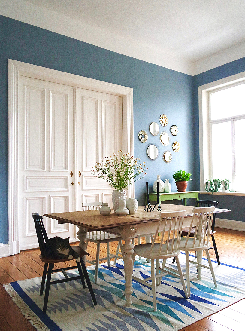 The pastel blue wall of a dining room gives it a special character
