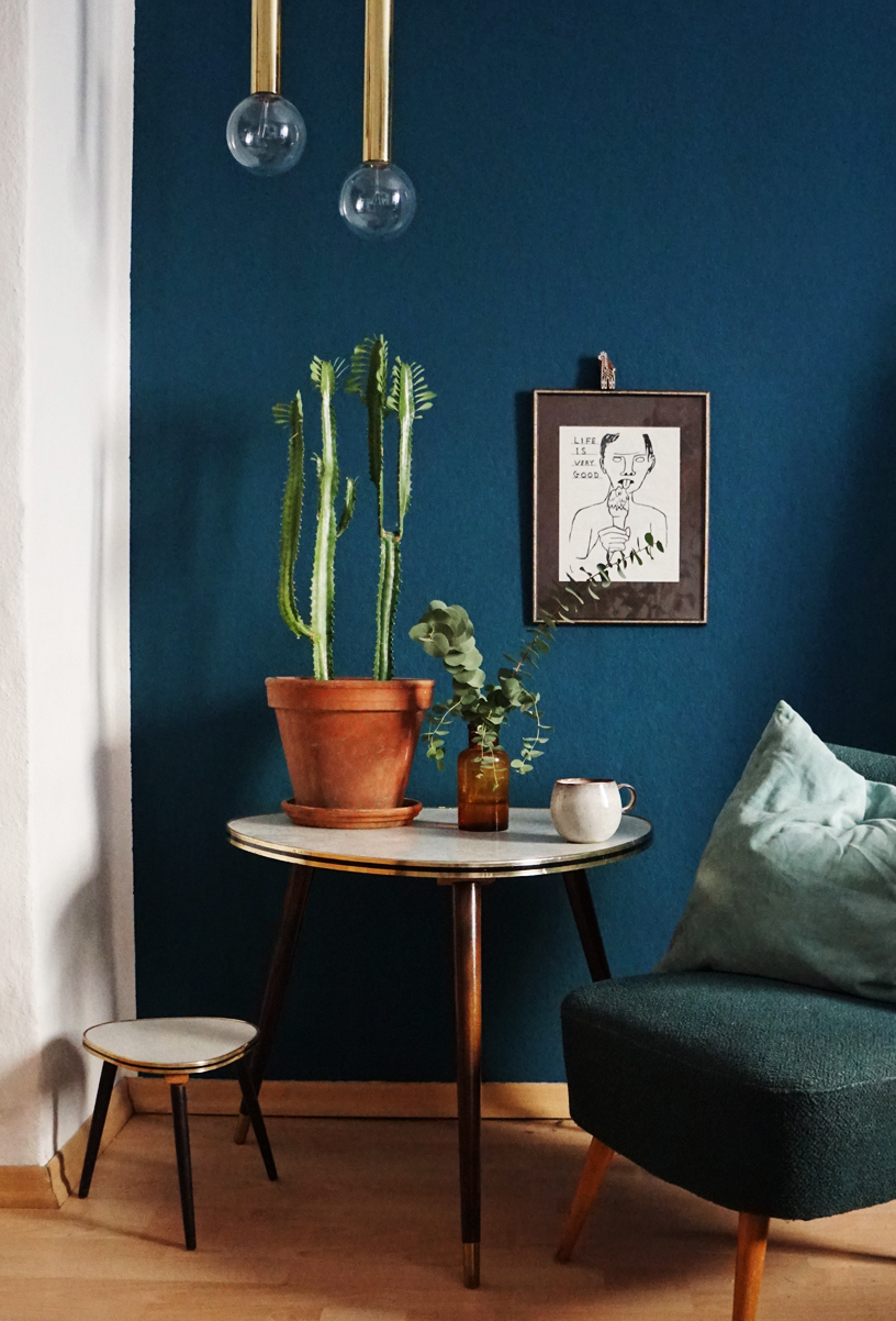 Vibrant dark blue wall color in a study adds coziness
