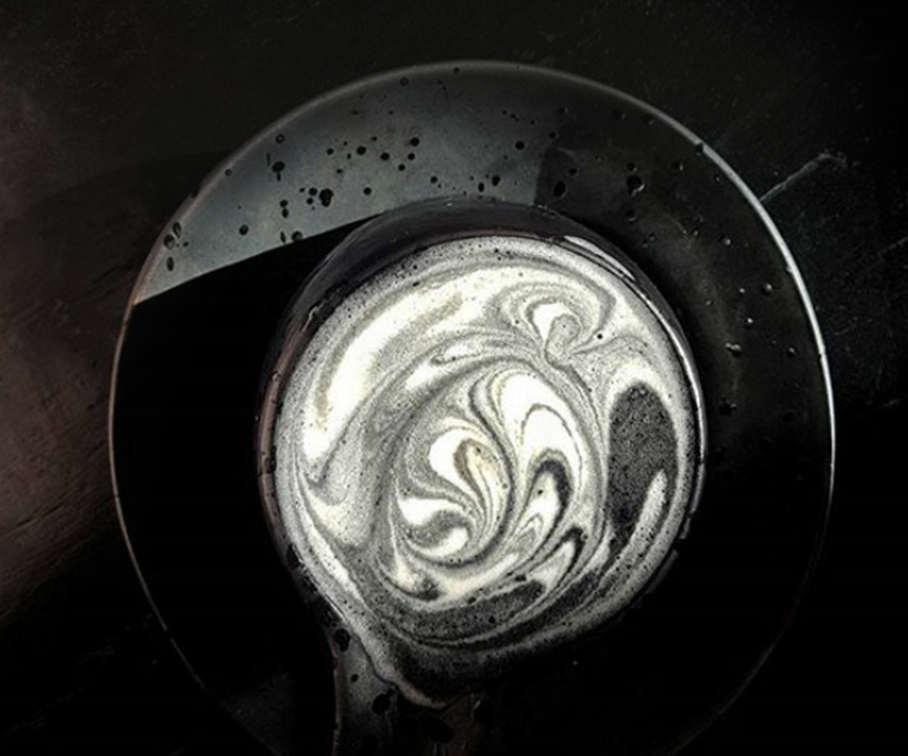 Close look on the black goth latte macchiato a speciality from Sozo-cafe in the USA