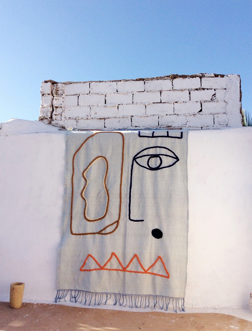 Ouaaajh is the new handmade blanket by LRNCE with an abstract tribal face design
