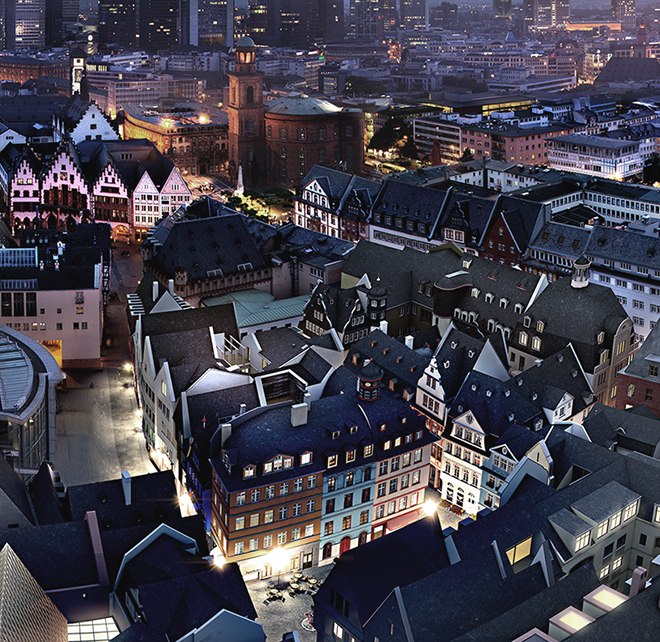 Aerial view on the rooftops of the new old town Frankfurt, the artful fronts are illuminated by the streetlamps