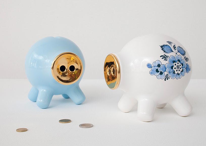 Two ceramic piggybanks with metallic noses in a modern design by Robert Bronwasser