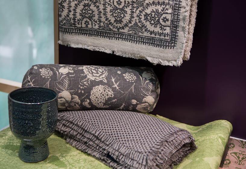 Cushion from Dorothee Lehnen, plant pot from Broste Copenhagen, plaid from Eagle Products and rug from PB Home Nordic at Ambiente 2018