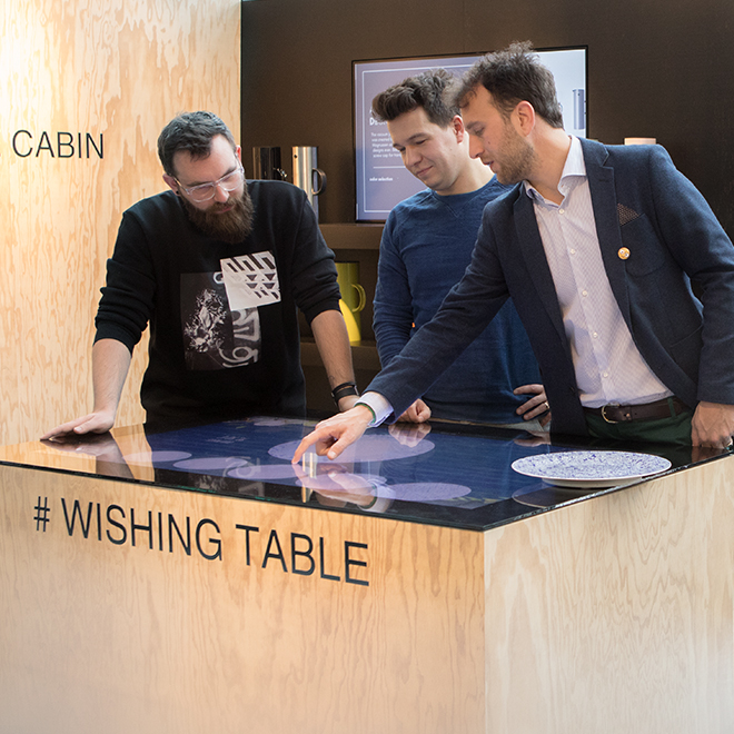 Fair visitors to Ambiente 2018 get a demonstration of the Wishing Table at the Point of Experience special presentation