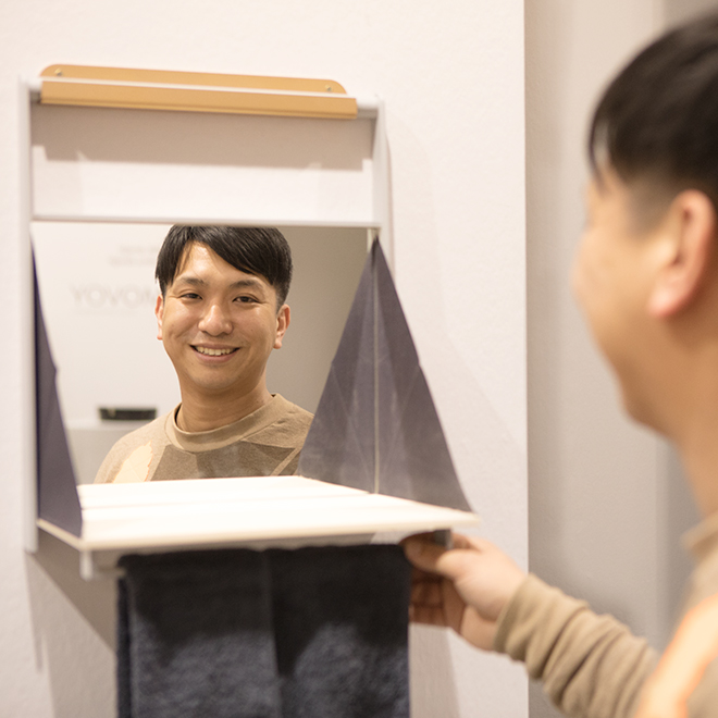 Man looks into wall mirror in the Talents area at Ambiente 2018