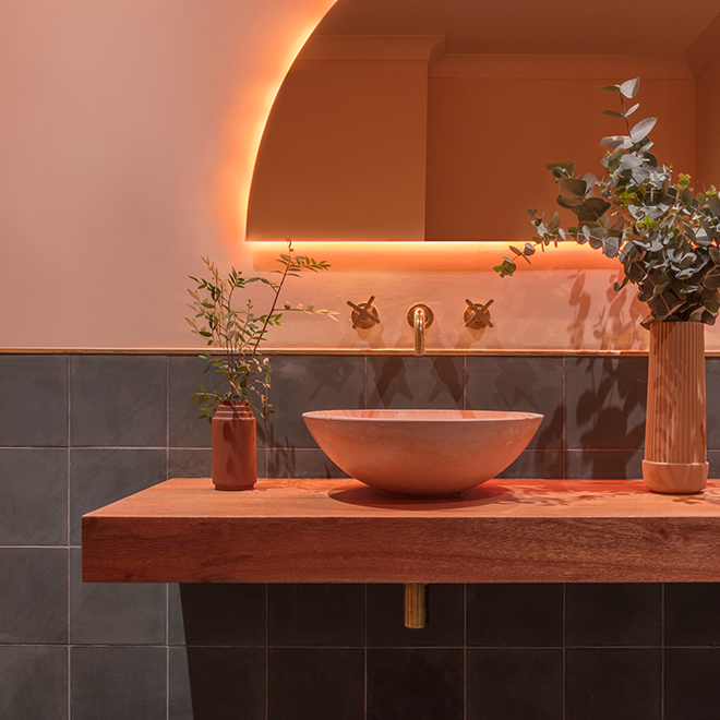 Terracotta-colored bathroom of the Mediterrenean restaurant Omar's Place in London