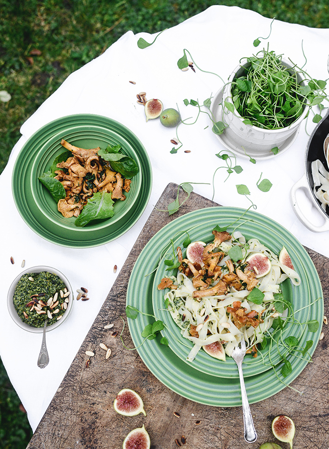 Green tableware with bowls and plates by Le Creuset