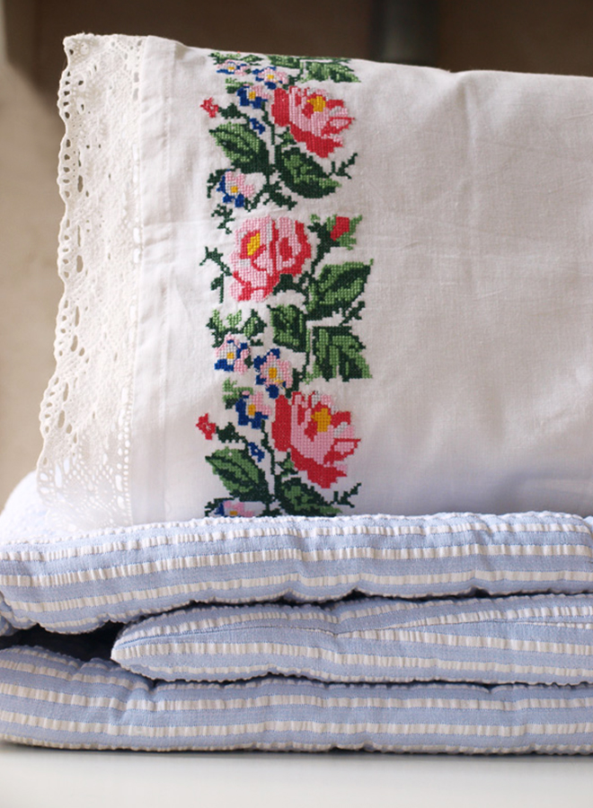 White cotton floral-embroided pillow by Ottomania